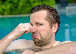 Why does the pool in my gym always stink of chlorine?