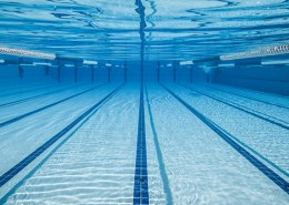 How many gallons is the average commercial swimming pool?